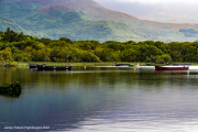 Ross castle lake with boats.jpg